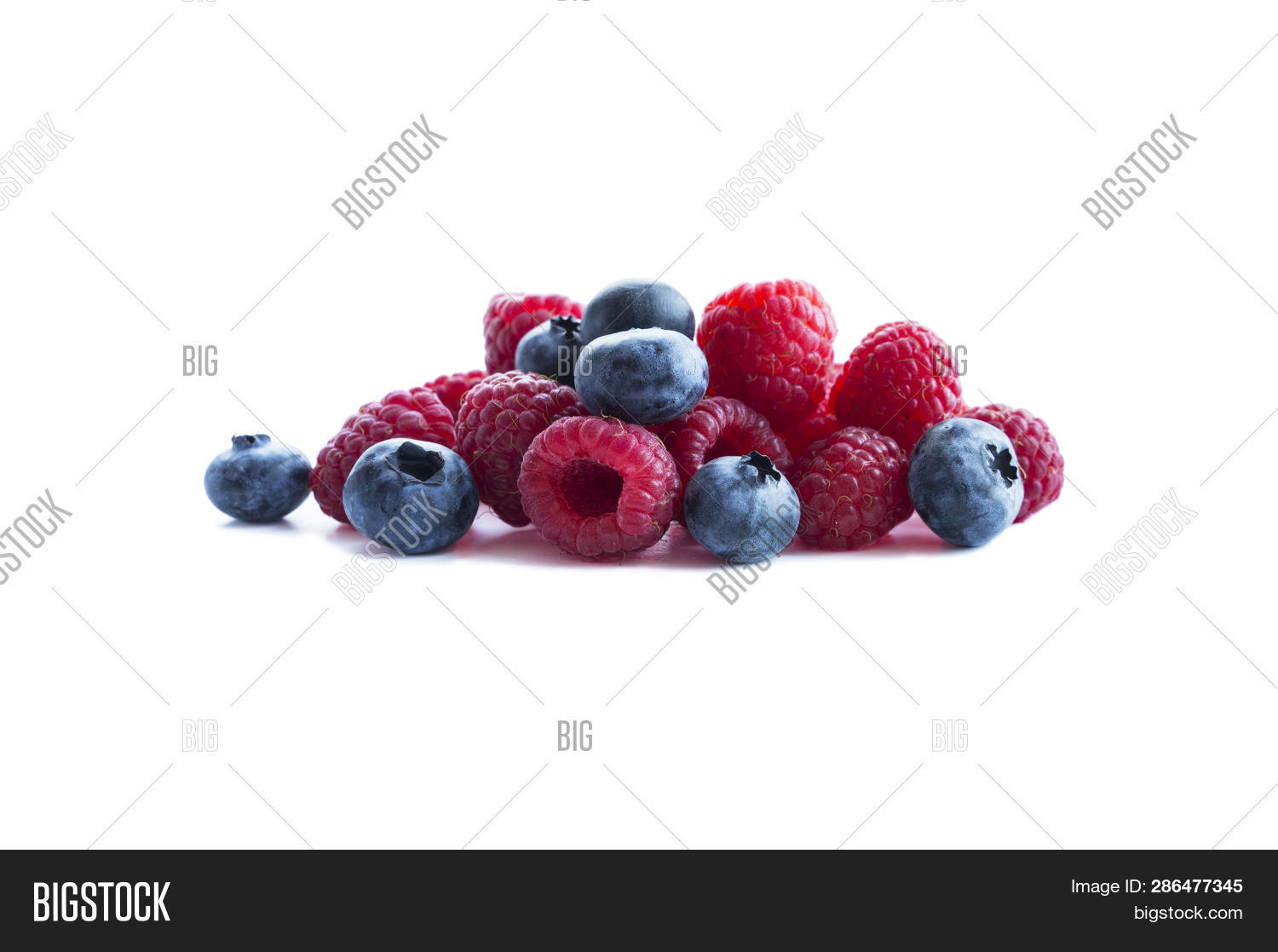Berries Isolated On White Background. Ripe Blueberries And Raspberries. Background Of Mix Berries Wi