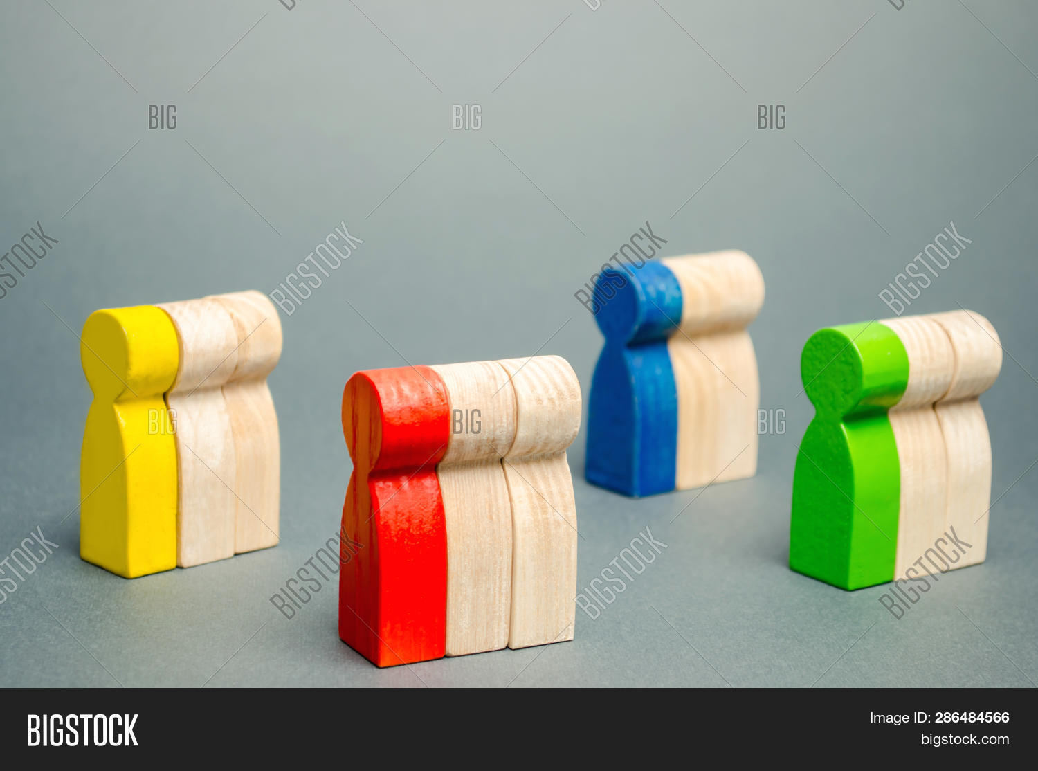 Groups Of Multicolored Wooden People. The Concept Of Market Segmentation. Target Audience, Customer