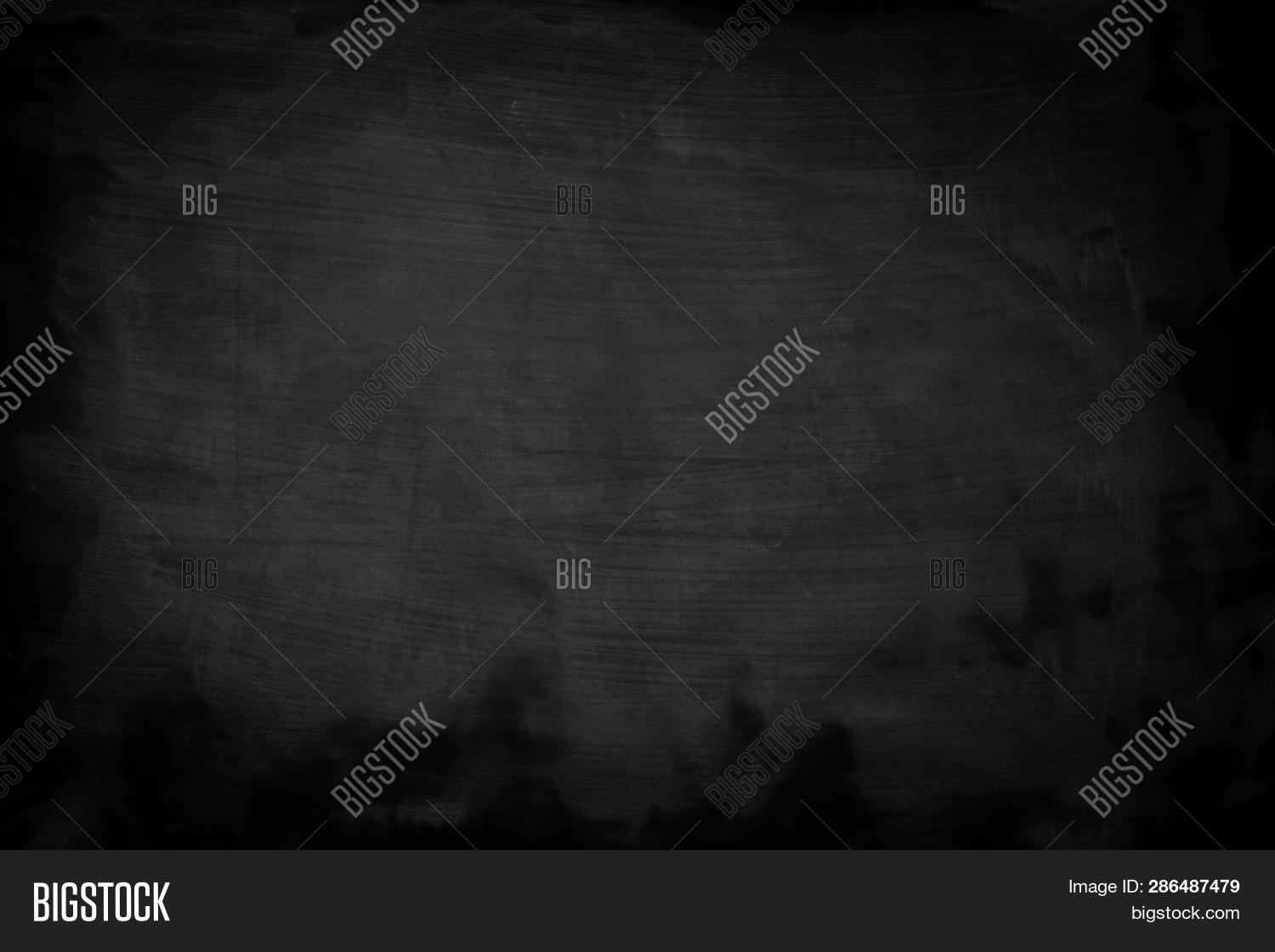 Abstract chalk rubbed out on blackboard or chalkboard background. Texture of a black chalkboard.Empty blank black chalkboard or chalk traces. Education and learning background with blackboard or chalkboard. Black chalkboard for sale offer advertising