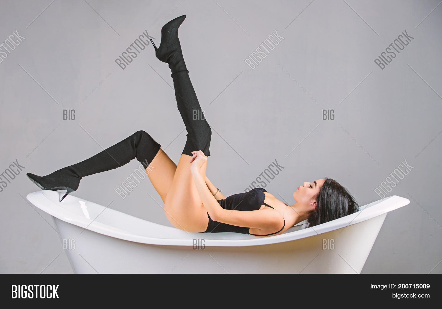 Fashion Sexy Model Seductive Posing On Bathtub. Every Girl Dream Become Desirable. Girl Relaxed Sexy