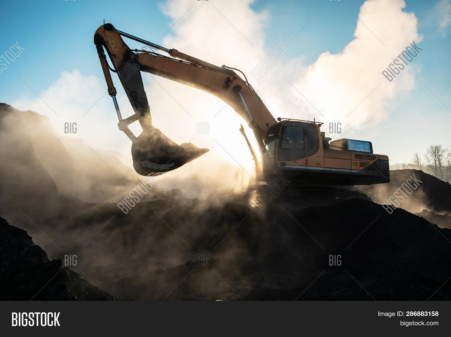action,activity,big,blue,bucket,build,building,bulldozer,construction,contractor,dig,digger,dirt,earth,earthmover,equipment,excavation,excavator,ground,heavy,hydraulic,industrial,industry,iron,job,land,large,loader,machine,machinery,mining,mover,outdoors,power,quarry,road,sand,scoop,shovel,site,sky,soil,technology,track,tractor,transport,vehicle,wheel,work,yellow