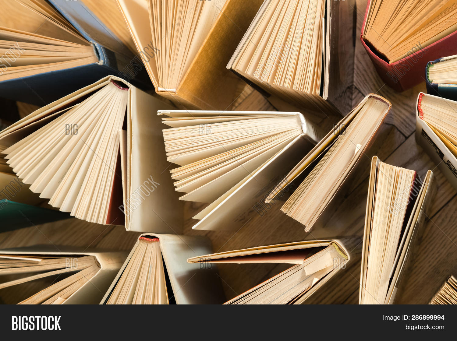 Old And Used Hardback Books, Text Books Seen From Above On Woode