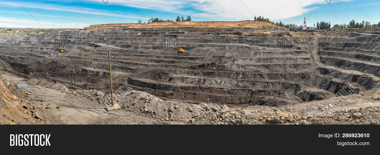 above,aerial,big,coal,deep,development,dig,digging,ecology,energy,environment,equipment,excavation,extraction,fossil,fuel,geology,industrial,industry,land,landscape,large,machinery,mine,miner,mineral,mining,mountain,nature,open,opencast,ore,outdoor,panorama,pit,power,production,quarry,road,rock,sand,soil,stone,surface,technology,top,transport,view,work