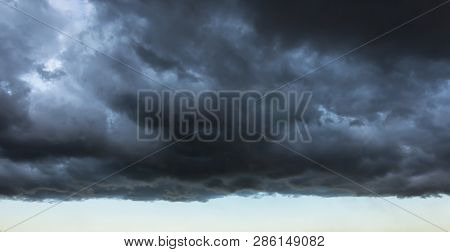 Dark cloud with a clear edge of the storm cloud, in front of a thundery front, weather changes stock photo