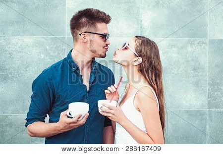 Nothing but very two hot beverages between you. Woman and man have latter drink. Couple in love drink coffee outdoor. Couple of woman and man with coffee cups. Enjoying the best coffee date. stock photo
