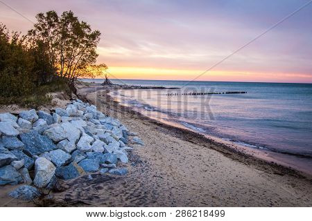 Michigan Beach Sunset. Sunset on the wild coast of Lake Superior with beach hut on the horizon in the Upper Peninsula of Michigan at Whitefish Point in the USA. stock photo