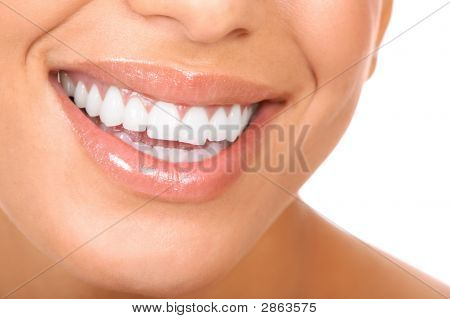 Smiling woman mouth with great teeth. Over white background stock photo