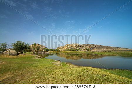 Waterbody at Pali, Bera hills, Pali district, Rajasthan, India stock photo