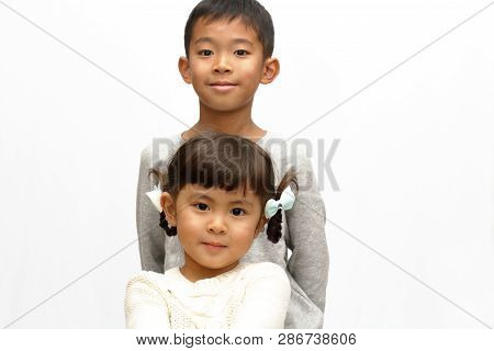 Japanese brother and sister (9 years old boy and 4 years old girl) stock photo
