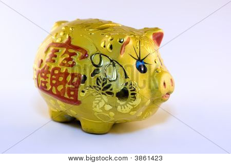 Yellow chinese money piggy bank with hieroglyph stock photo