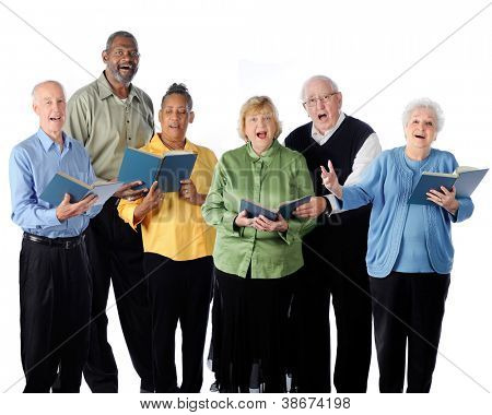 Six senior adults happily singing from song books.  On a white background. stock photo
