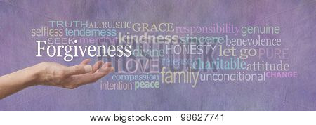 Female hand outstretched with palm up and the word Forgiveness hovering above surrounded by a relevant word cloud on a lilac colored stone effect background stock photo