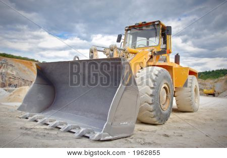 A large yellow bulldozer at construction site stock photo