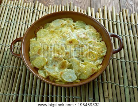 Pommes Anna classic French dish of sliced layered potatoes cooked in a very large amount of melted butter. stock photo