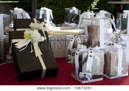 favors on a table outdoor with boxes for wedding stock photo