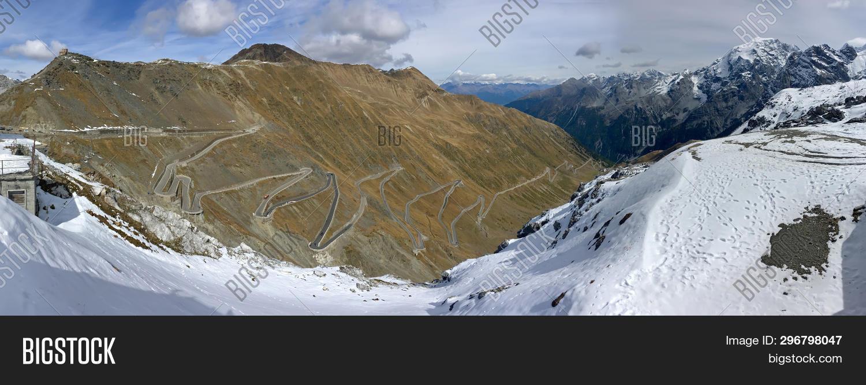 Panoramic view of Stelvio Pass, hairpin turns of mountain pass named Stilfser Joch in Deutsch, in It