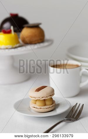 Elegant afternoon tea with cakes and macaron stock photo