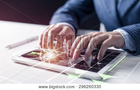 Businessman analyzing financial data. Virtual 3d interface above tablet computer screen. Interactive financial diagrams and digital data visualization. Modern smart technology in business process stock photo
