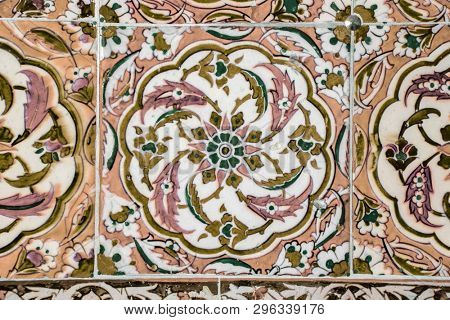 Texture of ceramic tiles in oriental East style. Turkish ceramic tiles lined on the wall. Old azulejo pattern floral ornament on floor. Ottoman traditional art. Moroccan portuguese mosaic background stock photo