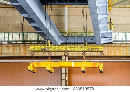 Overhead traveling crane with magnetic grippers traverse. Industrial area. stock photo