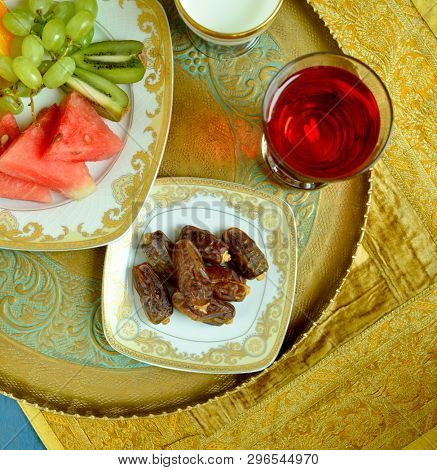 Nutritious and healthy food to eat before breaking Roza - a fast during holy month in Islam. Dates, milk, fruits and rose flavored sharbat. stock photo