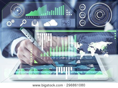 Businessman analysis trading diagram at tablet computer. Statistical model prediction to provide insights for financial and marketing strategy decisions. Financial infographics at virtual screen. stock photo