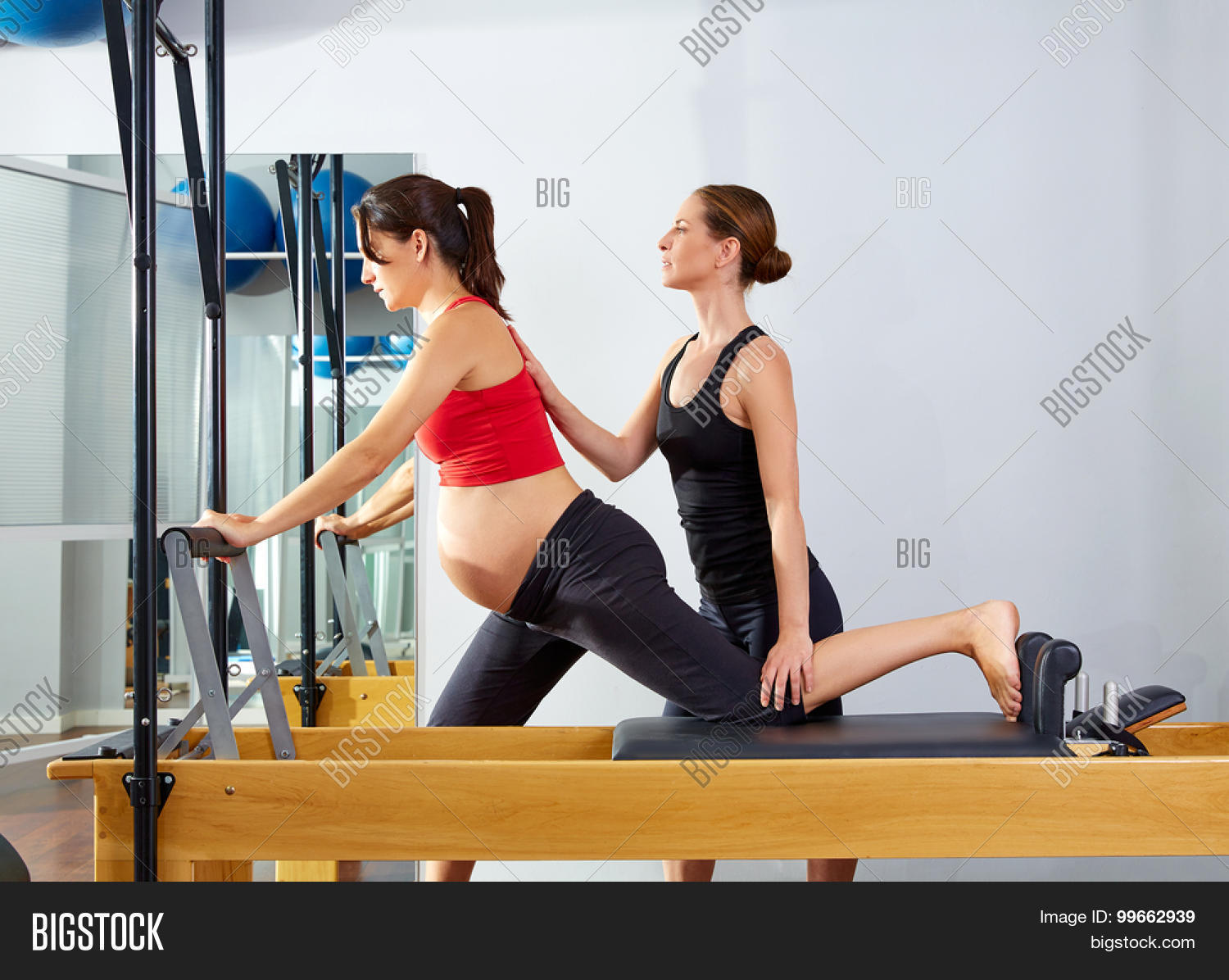 Pregnant Woman Pilates Reformer Cadillac Exercise Workout With Personal Trainer 99662939 Image Stock Photo