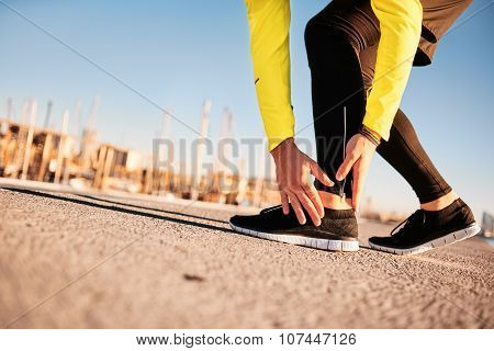 Broken twisted ankle - running sport injury. Athletic man runner touching foot in pain due to sprained ankle stock photo
