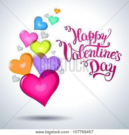 Several Multicolored Hearts And Original Hand Lettering  Happy Valentine\'s Day.