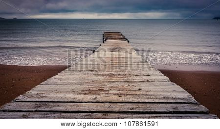 Small wooden pier leading into the sea in Paignton, Torbay, Devon, UK stock photo
