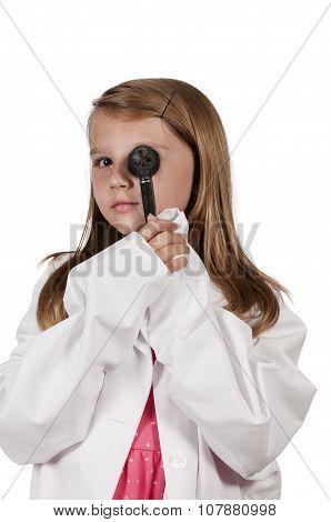 Little girl child doctor holding an otoscope stock photo