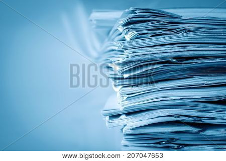 extreamely close up report paper stacking of office working document modern blue color tone stock photo