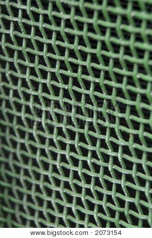 A green tractor radiator screen macro shot with the abstract thought of green screen as in computer program. stock photo