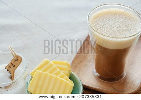 bulletproof coffee blended with organic grass fed butter and MCT coconut oil paleo keto ketogenic drink breakfast stock photo