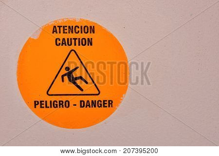 Damaged yellow and black warning sign on a boat stock photo