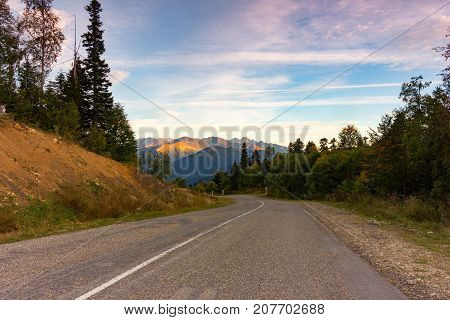 autumn natural landscape of the old road in the mountains stock photo