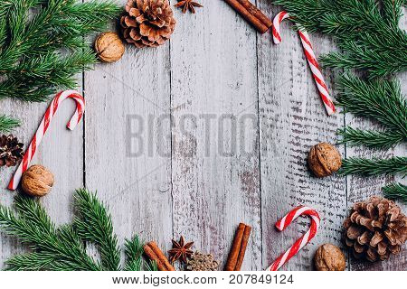 Christmas Composition Background. Cinnamon Sticks, Pine Cones, Fir Branches On Wooden Background. Fl