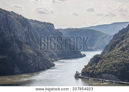 Mraconia Monastery in Romania taken from the Serbian part of Danube river in the Iron Gates (Portile din Fier). The monastery one of the symbols of Romanian Orthodox Church is one of the landmarks of the Danube gorges border bertween Serbia & Romania stock photo