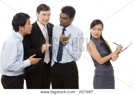 three businessmen talk about a female colleague behind her back stock photo