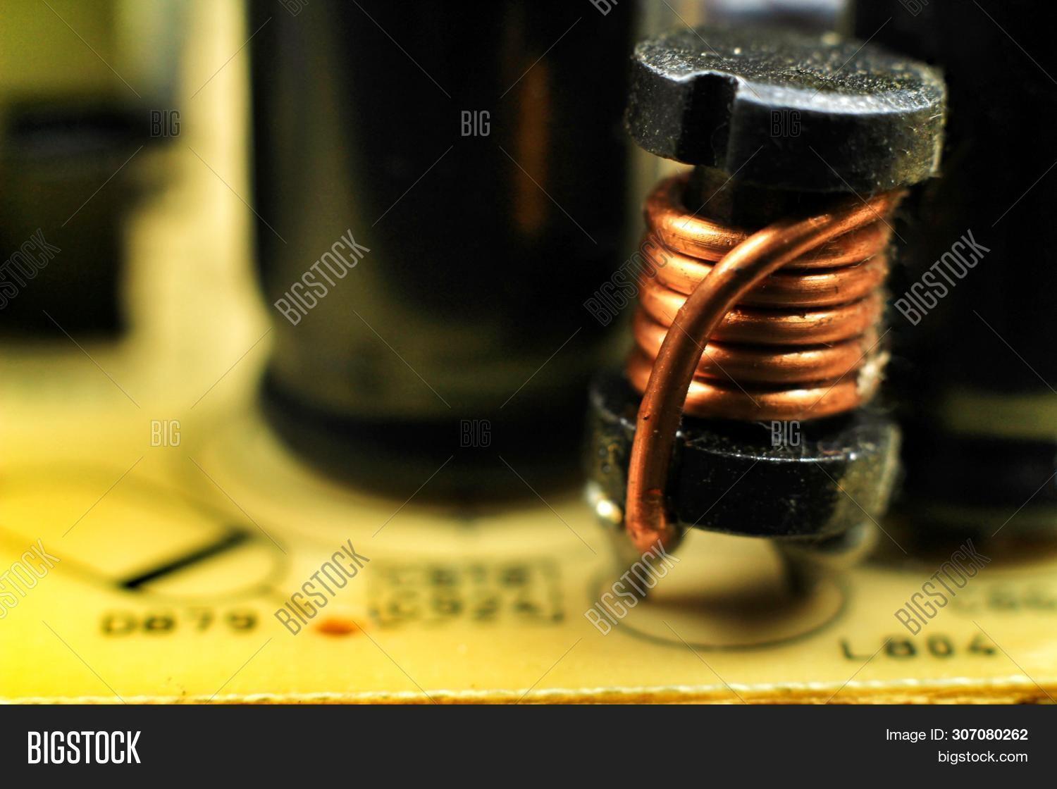 cable,choke,circuit,close-up,closeup,coil,component,copper,current,detail,device,electric,electrical,electricity,electromagnet,electromagnetic,electronic,engineer,equipment,flux,generator,glossy,inductance,induction,inductor,industrial,industry,macro,magnetic,magnetism,metal,metallic,neat,phase,pole,power,reactor,reflective,rotor,shaft,spiral,stator,steel,supply,technology,transformer,voltage,wire,wound
