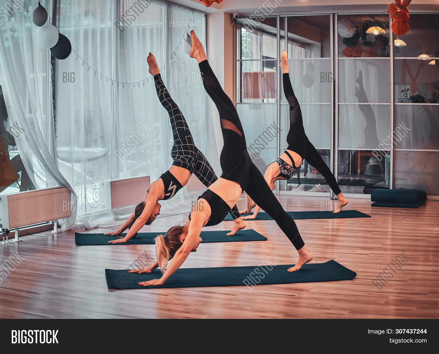 Few Young Womens Are Enjoying Joga Classes At Cozy Studio.
