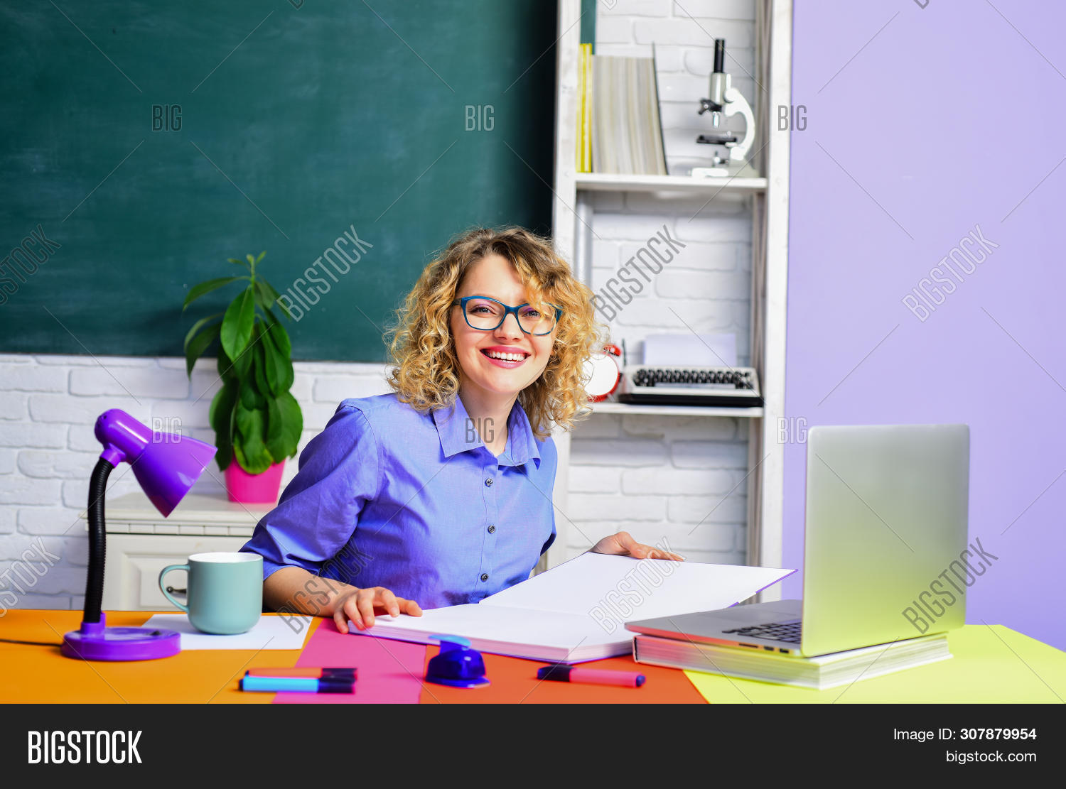 Smiling Female Teacher. Student Studying In The Classroom. Funny Teacher In The Classroom. Teacher.
