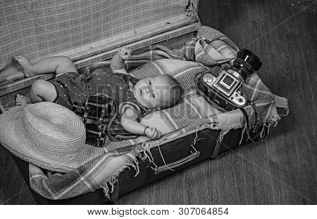 Multiple tasks. Portrait of happy little child. Sweet little baby. New life and birth. Family. Child care. Small girl in suitcase. Traveling and adventure. Childhood happiness. Photo journalist. stock photo