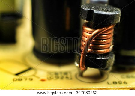 Closeup of and electromagnetic coil on a motherboard stock photo