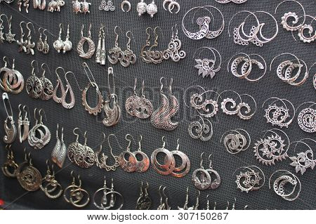 Silver rings of different models with semiprecious stone and shells stock photo