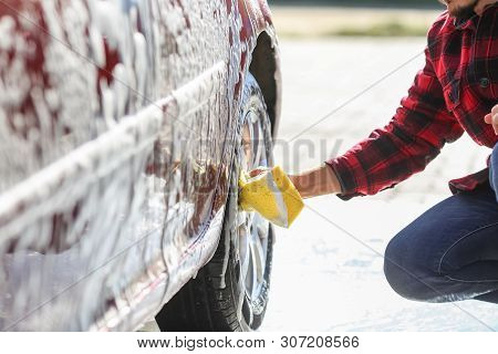 alloy, auto, automobile, black, bubble, business, car, care, cars, clean, cleaner, clear, dirty, equipment, exterior, flow, foam, garage, glass, hand, hose, indoor, interior, jet, luxury, man, nozzle, people, reflection, service, serviceman, shiny, soap,  stock photo