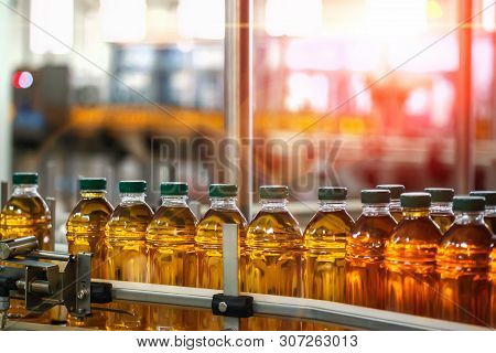 Production Line Of Juice On Beverage Plant Or Factory, Modern Computerized Industrial Equipment. Fre