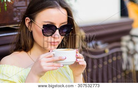 good morning. Breakfast time. stylish woman in glasses drink coffee. girl relax in cafe. Business lunch. morning coffee. Waiting for date. summer fashion. Meeting in cafe. Her perfect breakfast stock photo