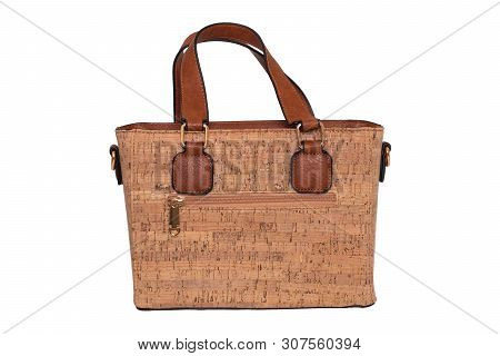 Hand bag isolated. Fashionable brown female luxury women bag  made from oak cork isolated on a white background. Womans accessories. stock photo