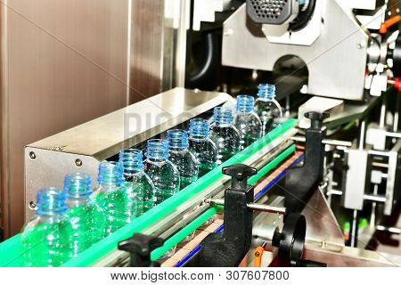 Clear Plastic Bottles Transfer On Automated Conveyor Systems Industrial Automation For Package